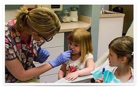 framed-hygienist-counting-teeth